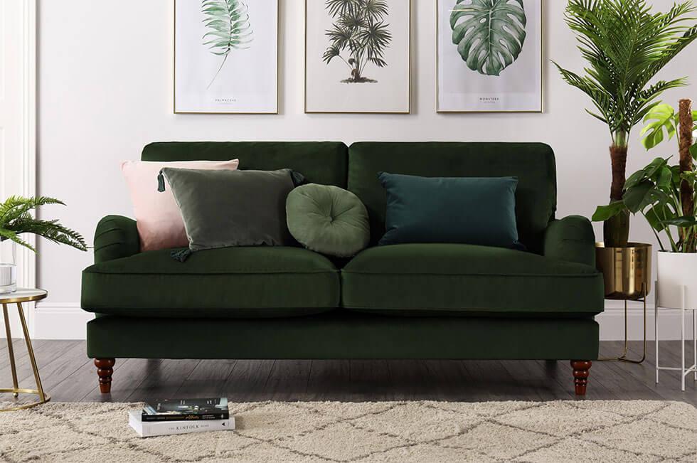 Green velvet sofa in a contemporary living room