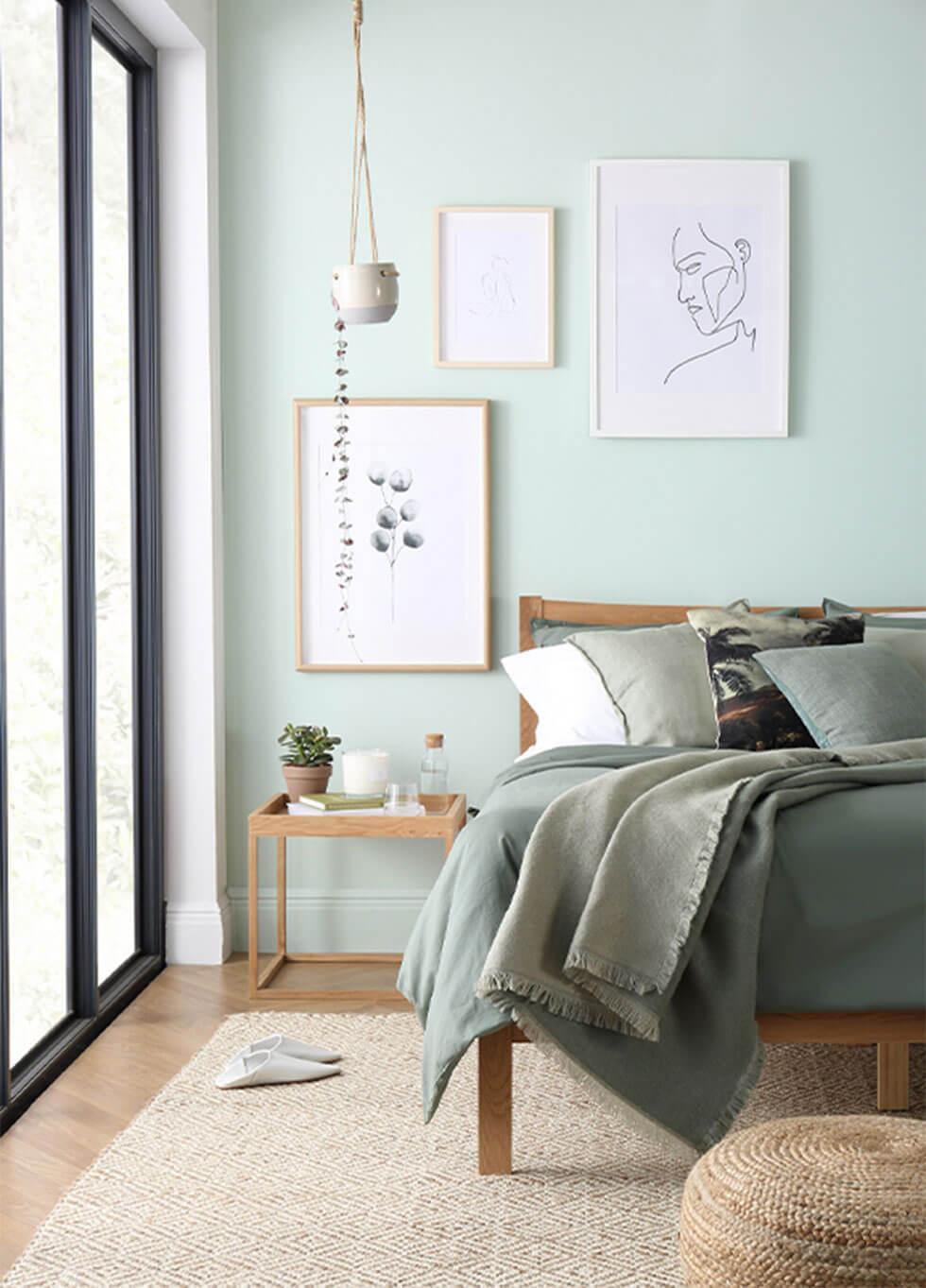 Sage green walls in a calm serene bedroom