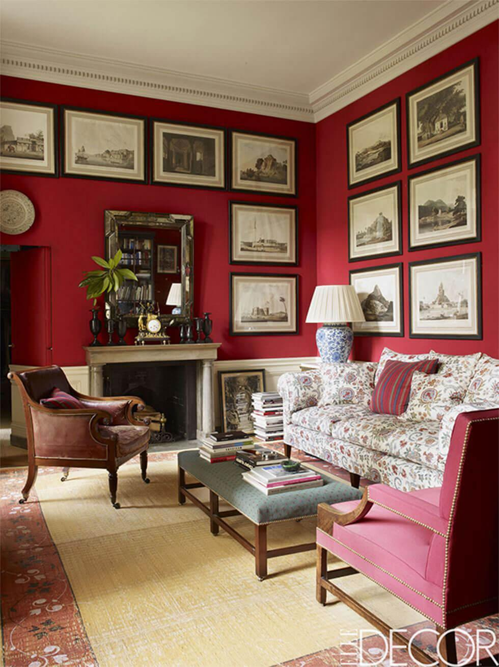 Classic red living room with a gallery wall and printed fabric sofas