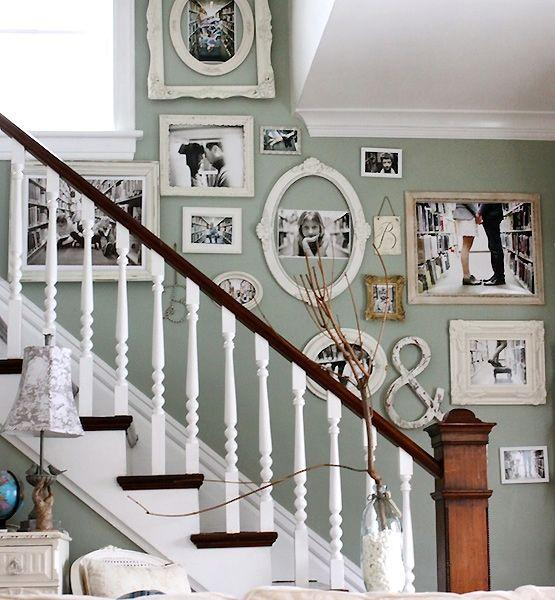 White vintage-inspired stairs with framed photographs.