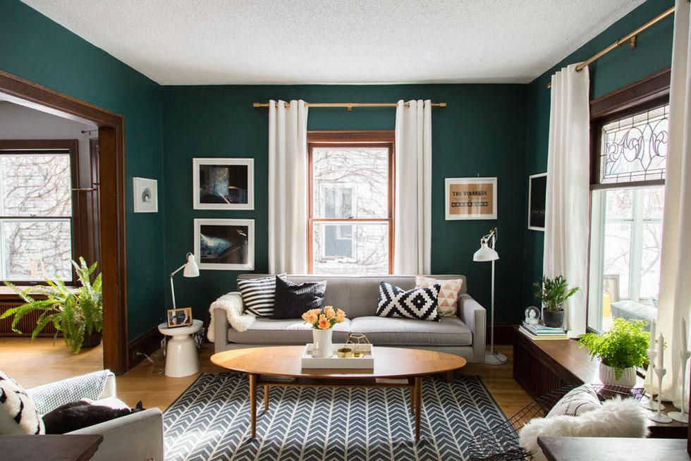 Living room with dark green walls and wooden furniture