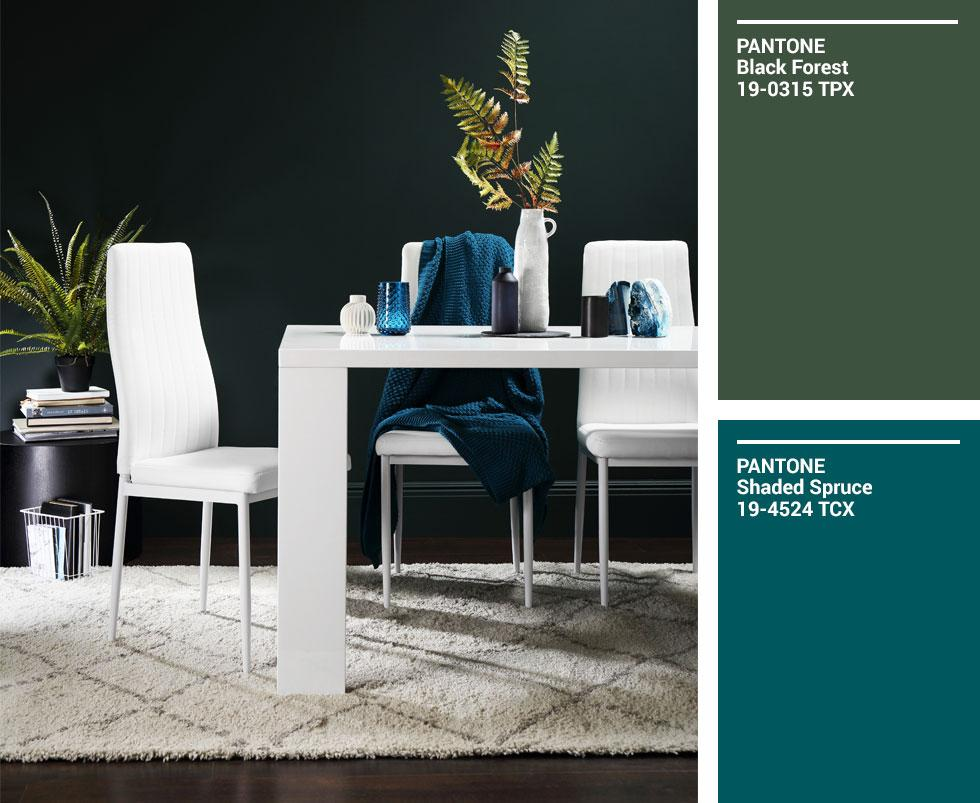 Collage of white wood dining set against a dark green wall.