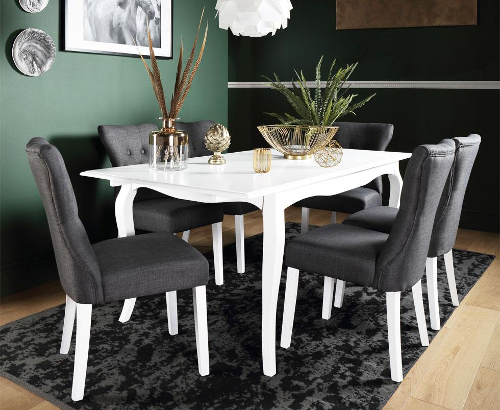 White and grey dining set in a dark green room.