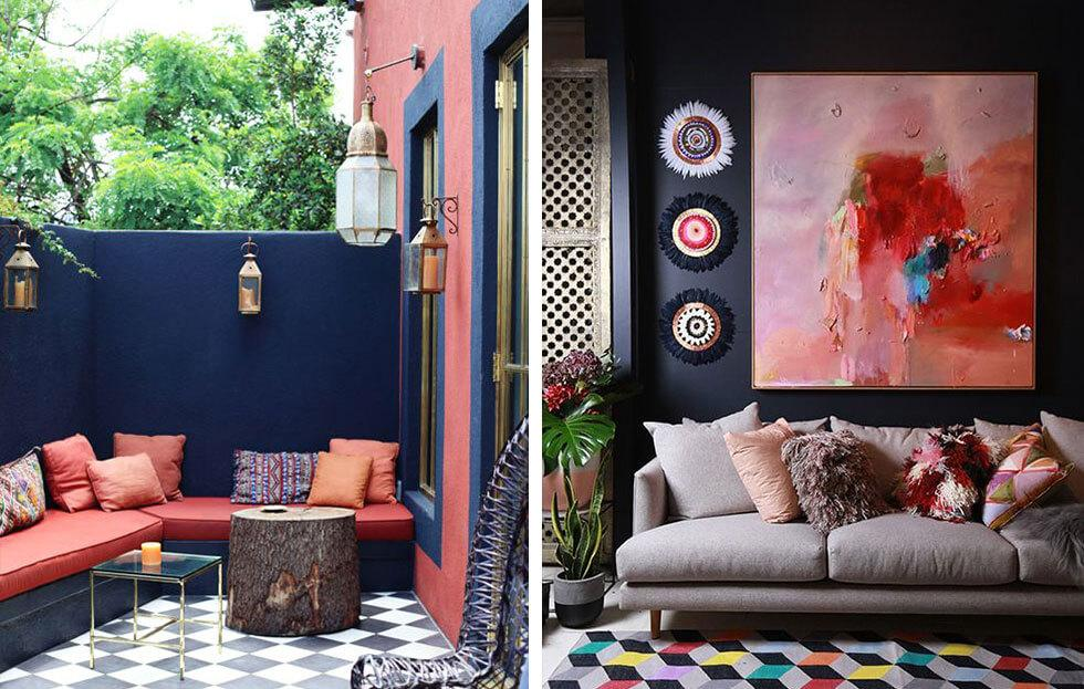 Dark navy walls with coral decor and furniture.