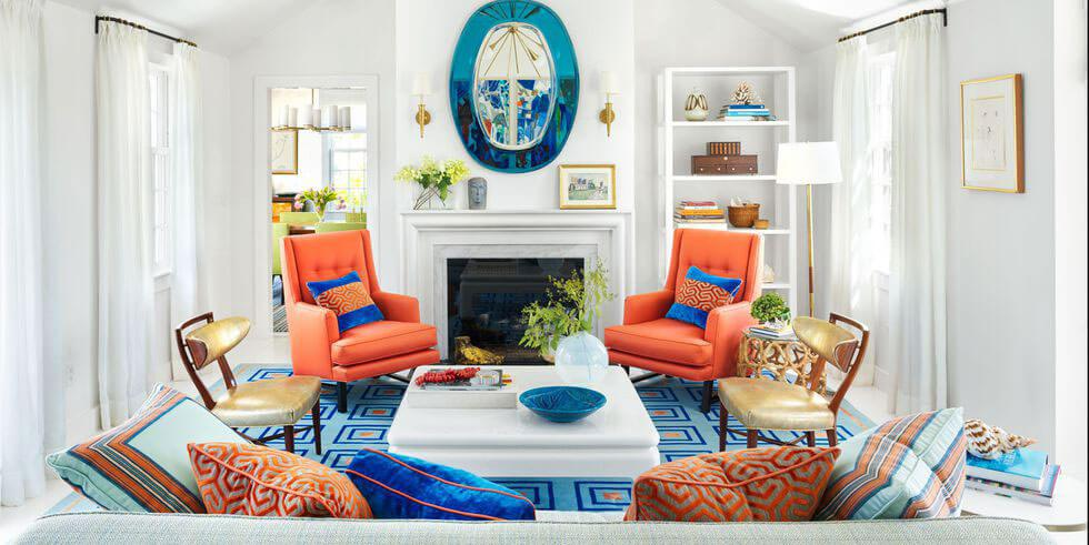 An airy living space with bright coral and blue elements.