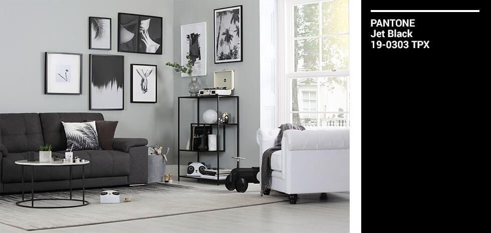 Living room with monochromatic decor elements and furnishings.