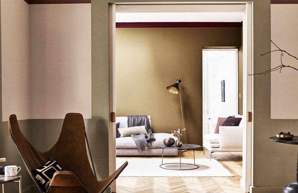 A warm beige interior with light and dark furniture.