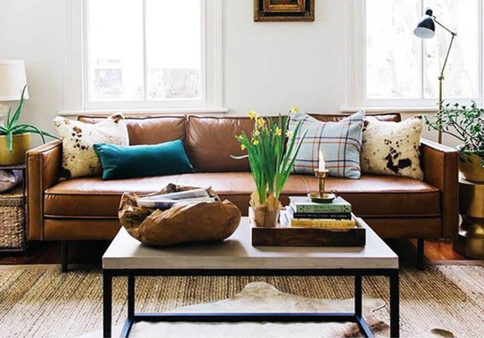 A brown sofa in a neutral space.