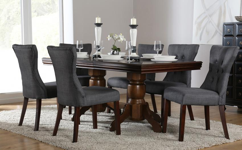 Grey fabric chairs and dark wood table