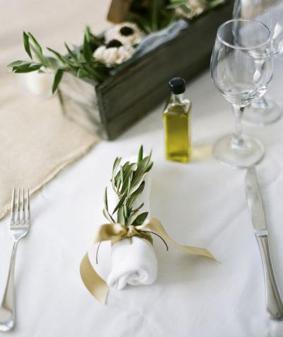 Table setting with leaves and linen.
