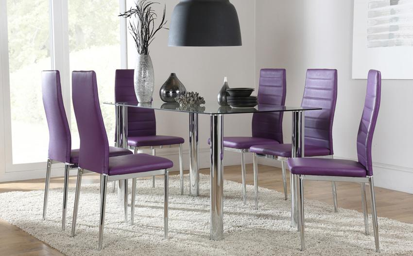 Glass table with round steel legs and purple chairs.