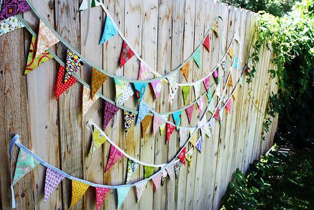 Party decoration on wooden fence.