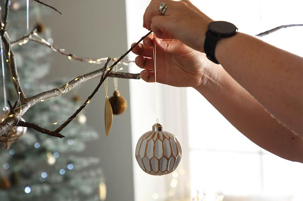 Decorating with Christmas baubles.