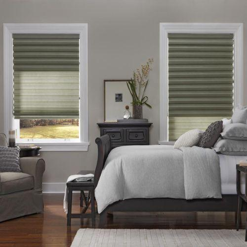 Grey and white bedroom, with dark furniture and Venetian blinds