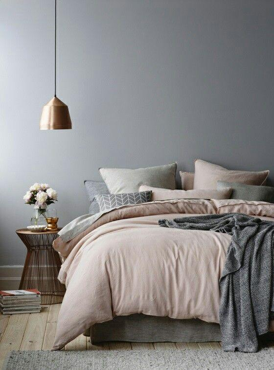 Grey and pink bedroom with a brass lamp