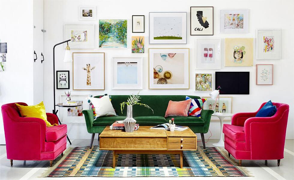 A bold living room with fuchsia and green velvet furniture.