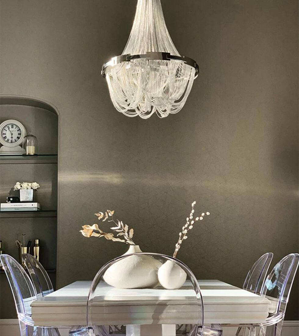 Neutral dining room with white dining table and Philippe Starck Ghost chair