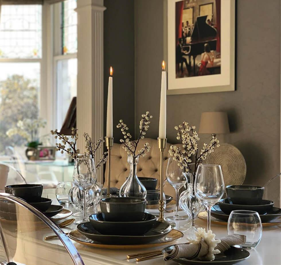 Sophisticated table setting with plates, bowls and wine glasses