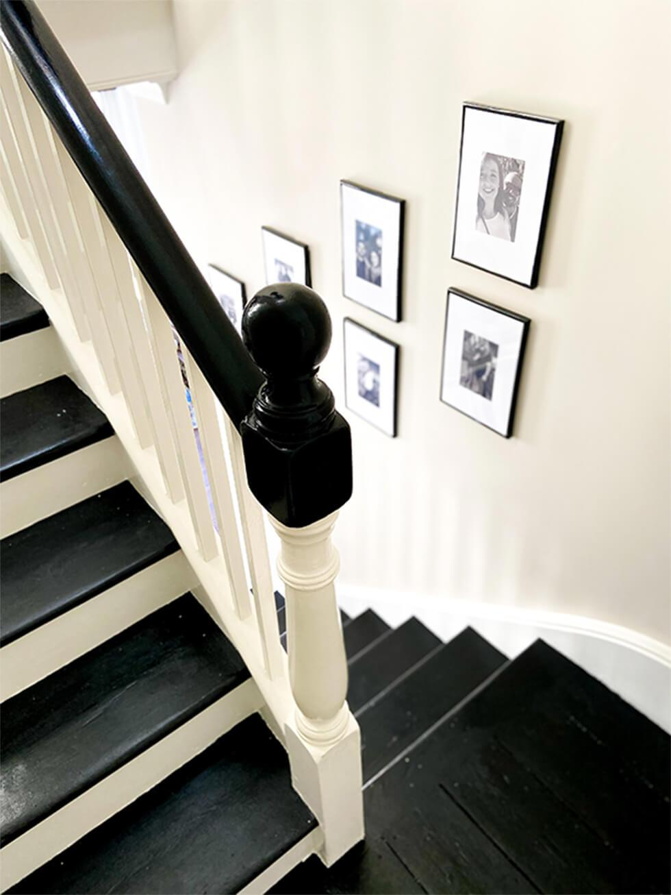 wooden staircase with gallery wall
