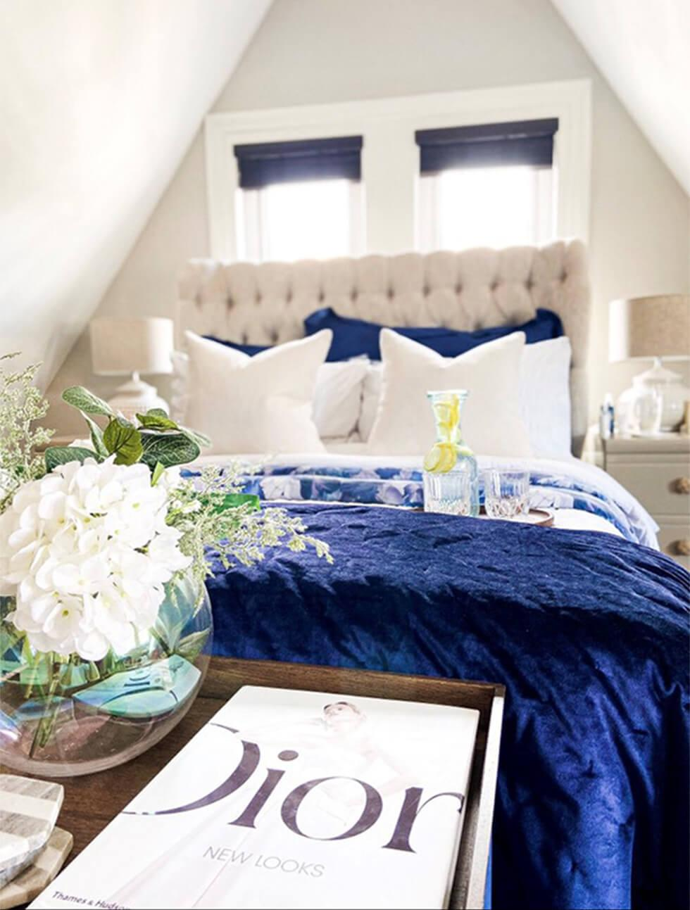 bedroom with farmhouse decor and blue bedding