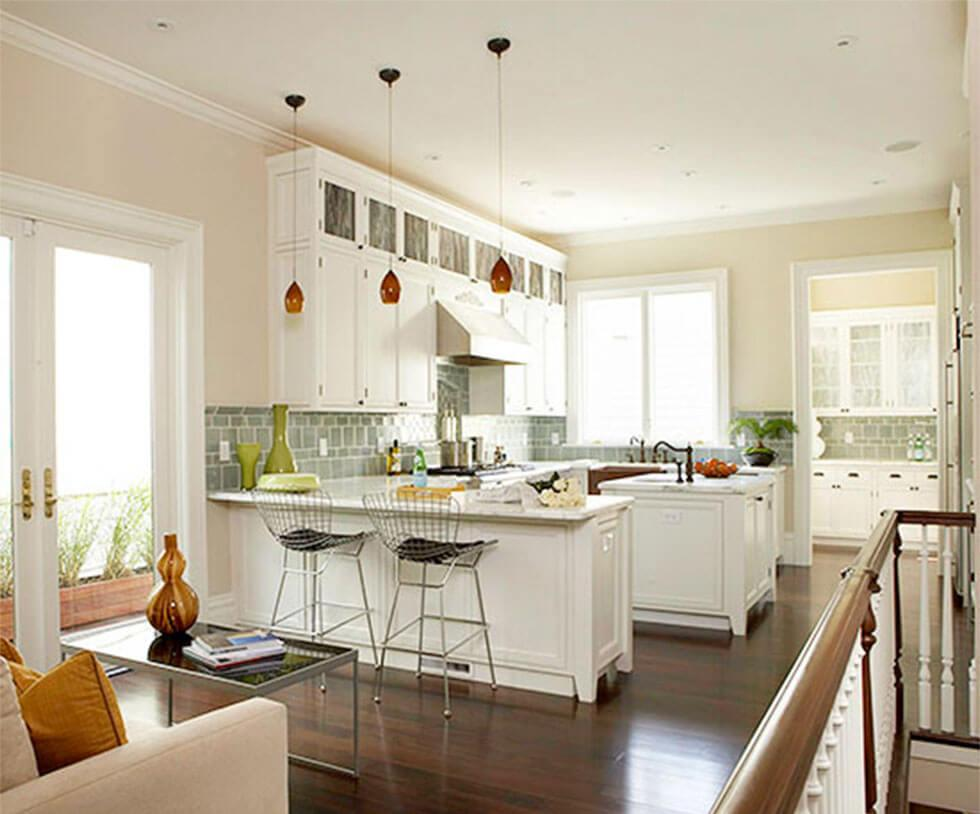 Classic open plan kitchen and dining room with white cabinets and kitchen island and plenty of storage