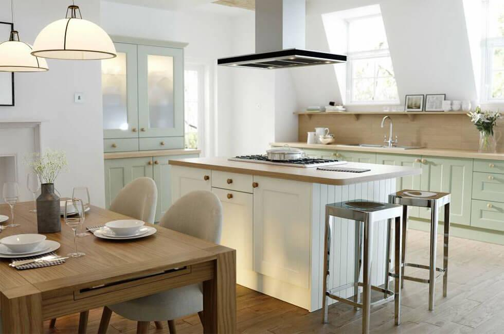 White and wooden open plan kitchen with a cooking hood, kitchen island and lamps.