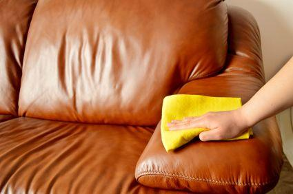 Wiping a light brown leather sofa