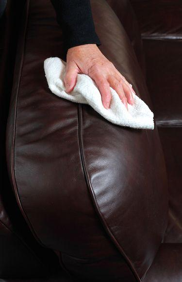 Wiping a brown leather sofa