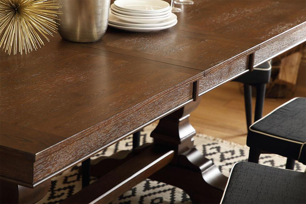 Close up of elegant, polished dark wood dining table