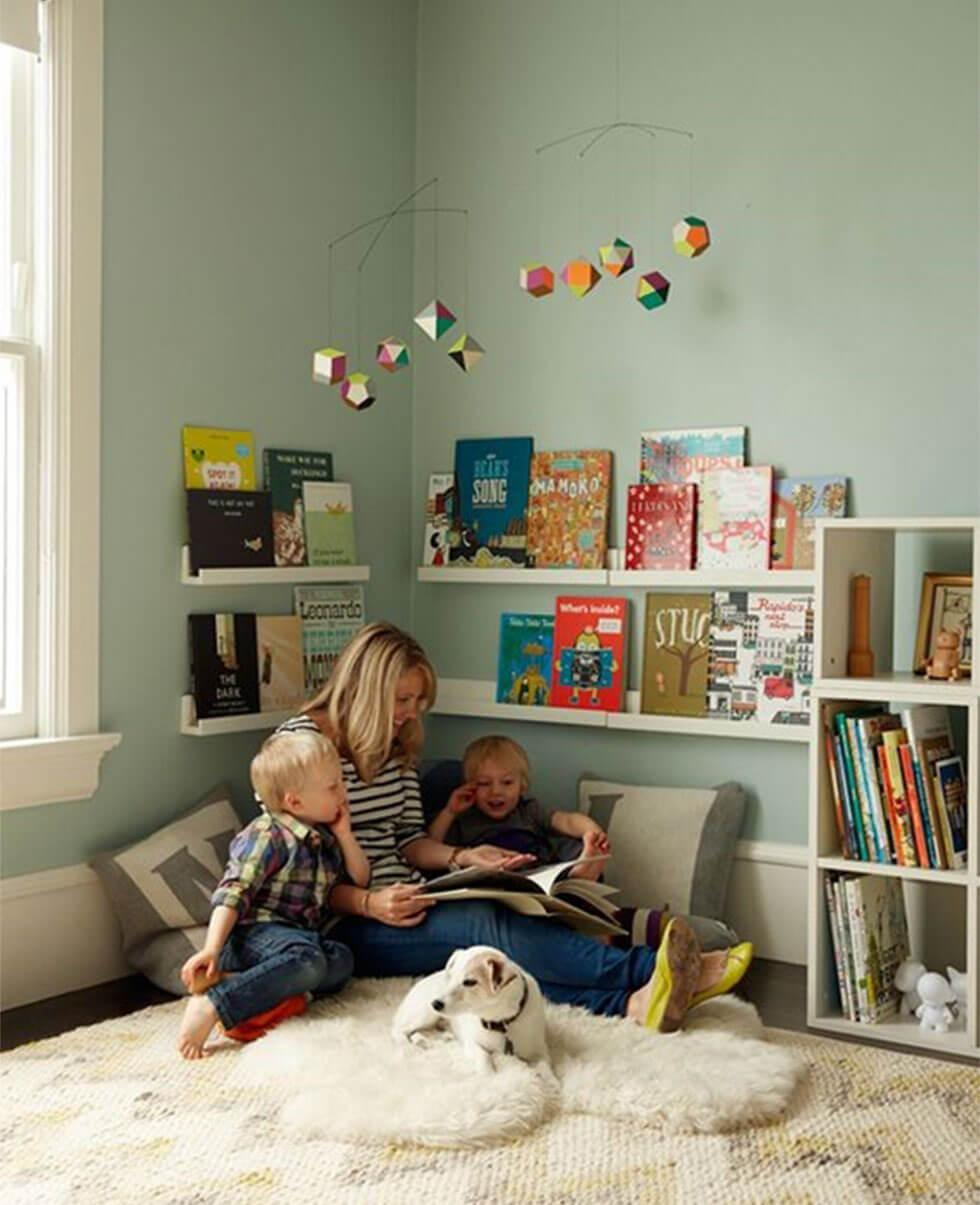 cosy children's reading nook in blue bedroom with a dog