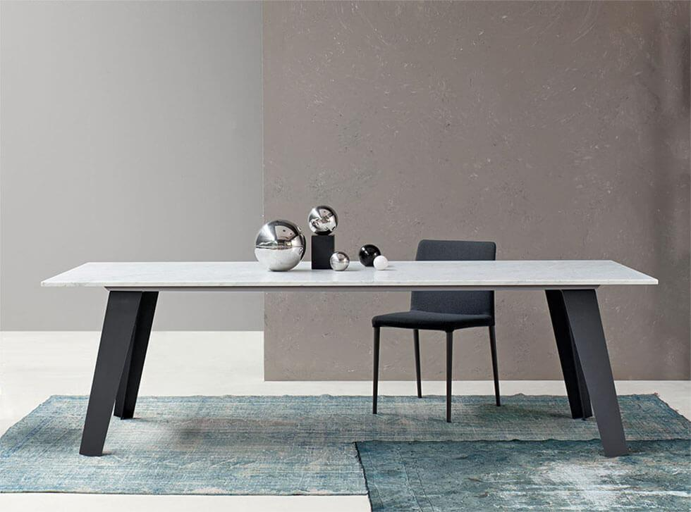 Marble dining table with minimalist accessories