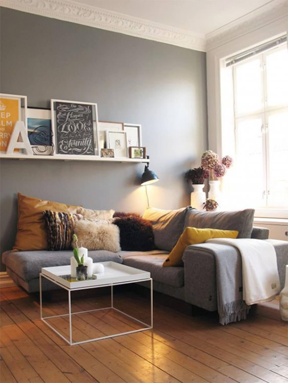 Grey corner sofa in a small living room.