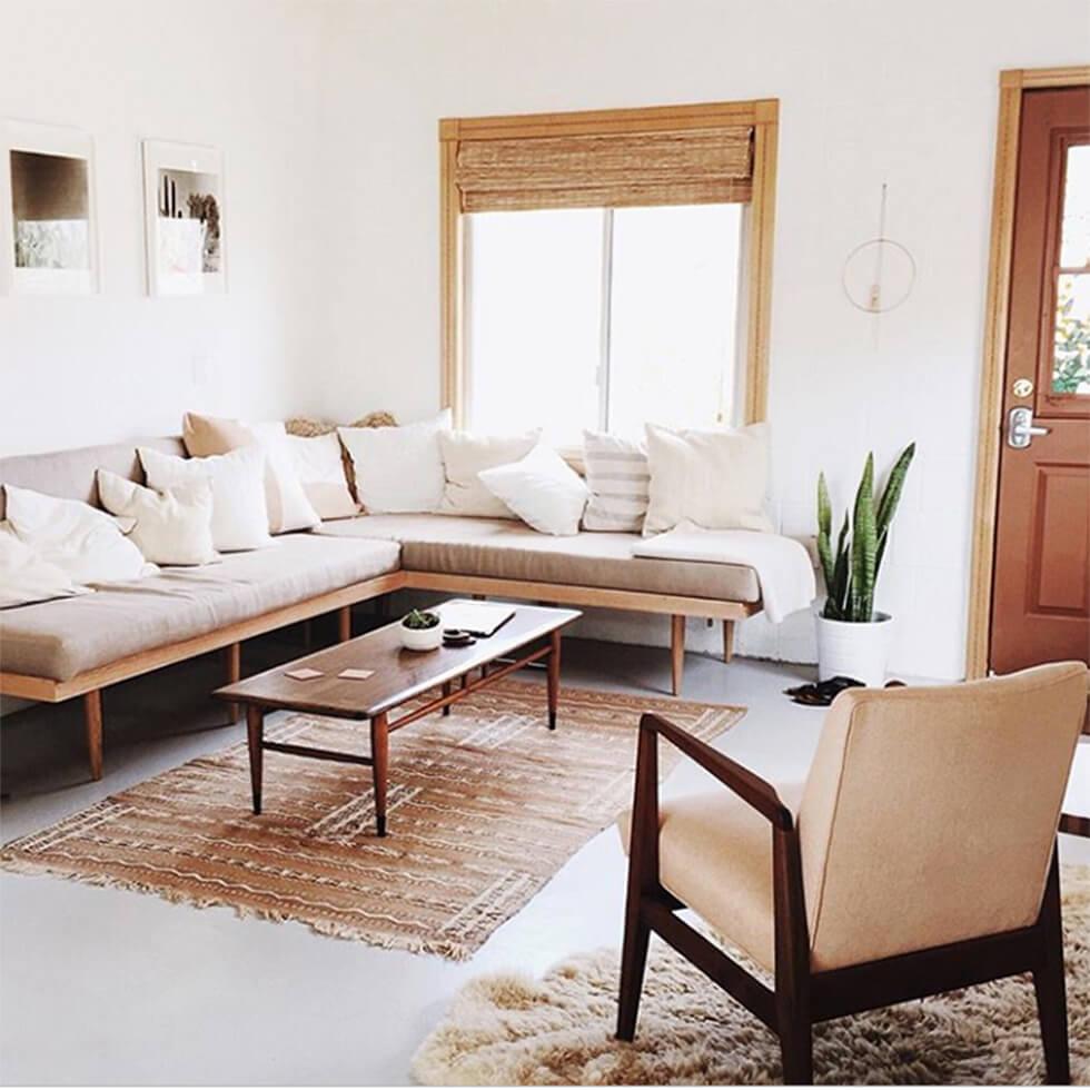 Beige corner sofa in a desert inspired living room.