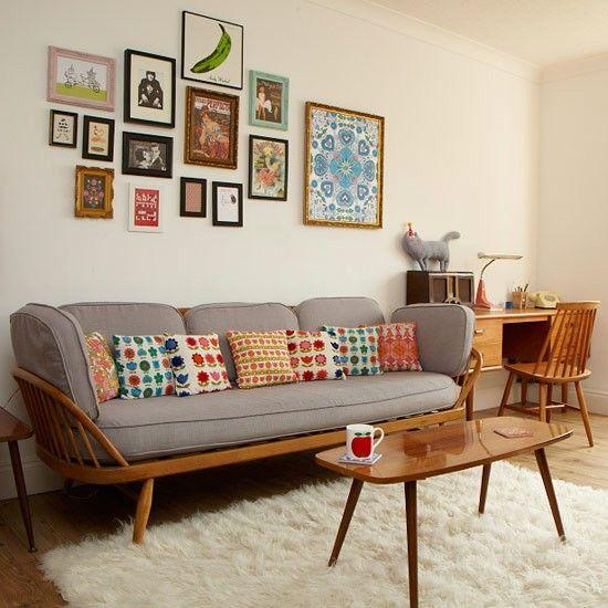 Mid-century modern wood and grey sofa with art framed on walls