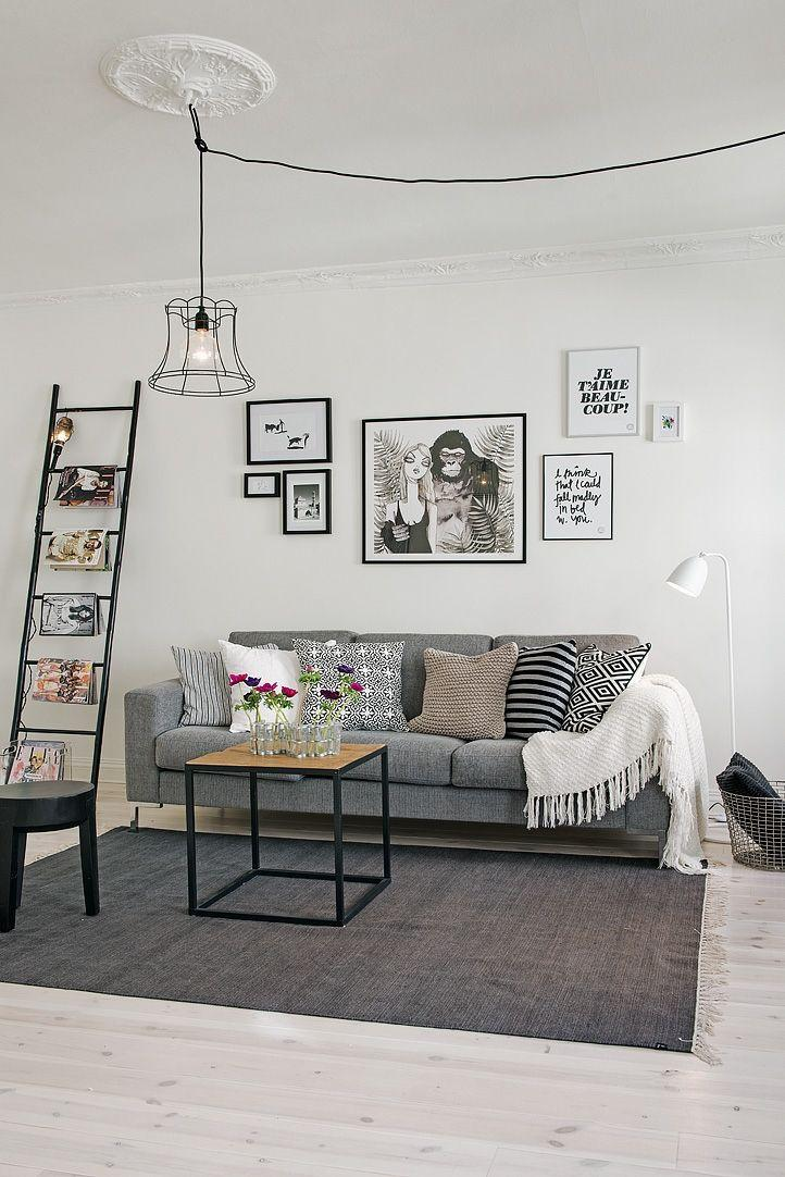 Grey sofa with minimal, industrial black and white decor