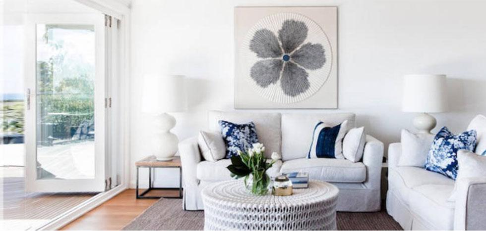 White living room furniture with blue cushions