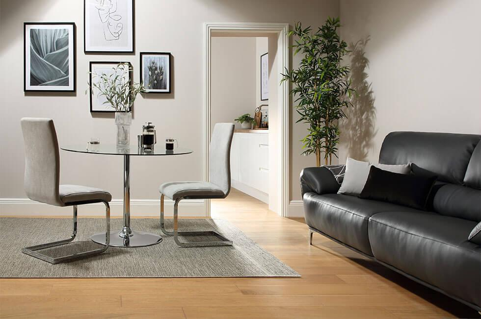 A small dining and living room space with a glass table.