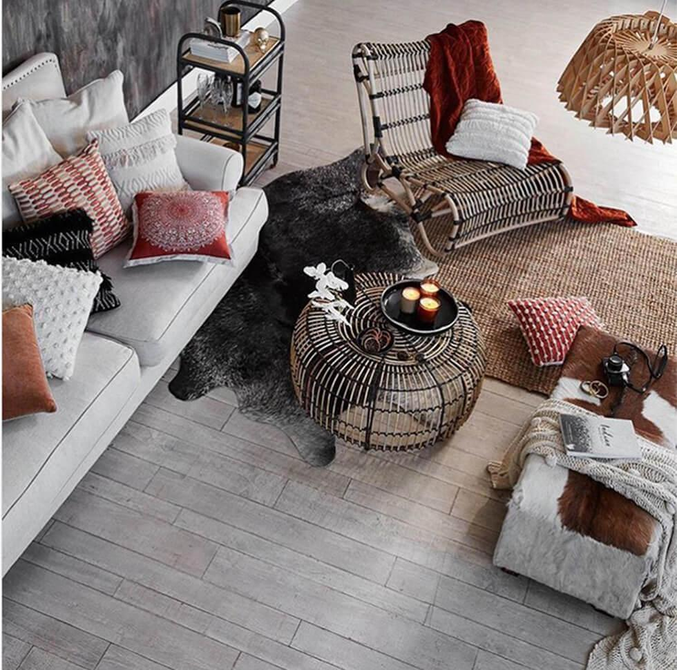Rustic living room with rattan accessories and cosy fabrics