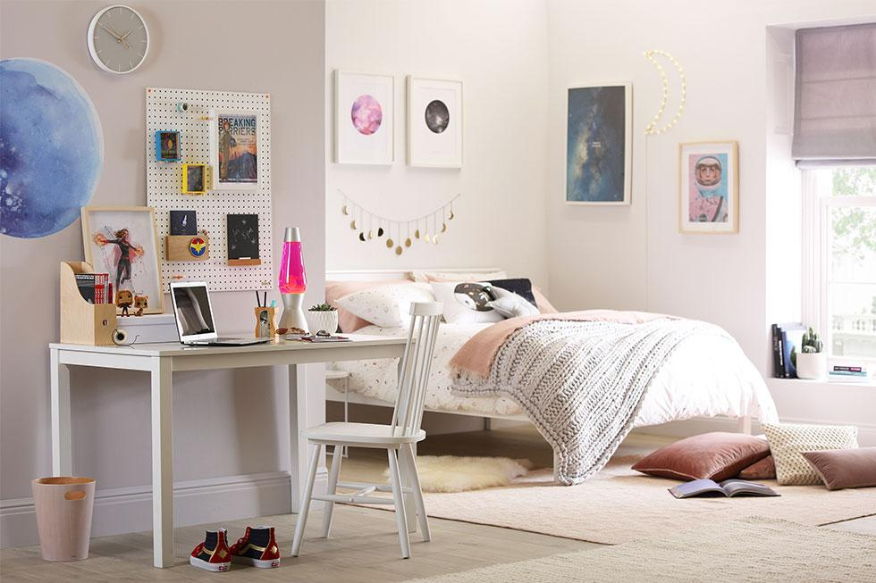 A white bedroom with space and superhero décor.