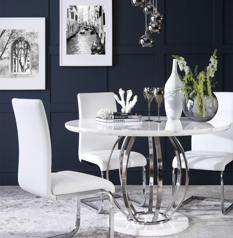 White dining set against dark wall.