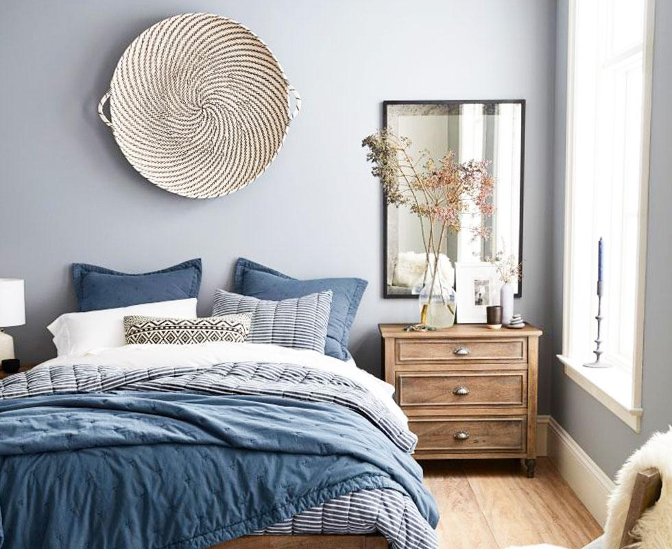 Blue and grey-themed bedroom.