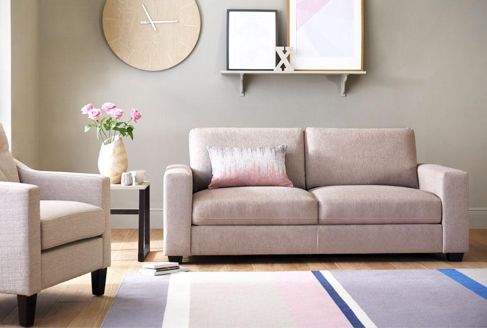 Beige sofas and multicoloured rug.