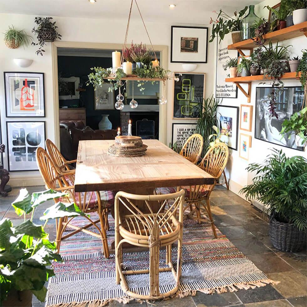 Eclectic dining room with indoor plants and wooden furniture