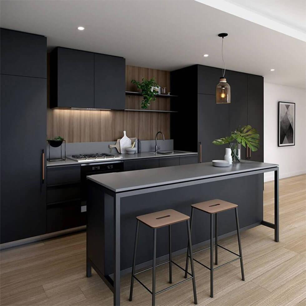 Matte black kitchen with contrasting white walls and wooden flooring