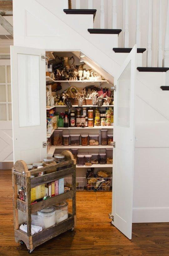 Pantry under the stairs.
