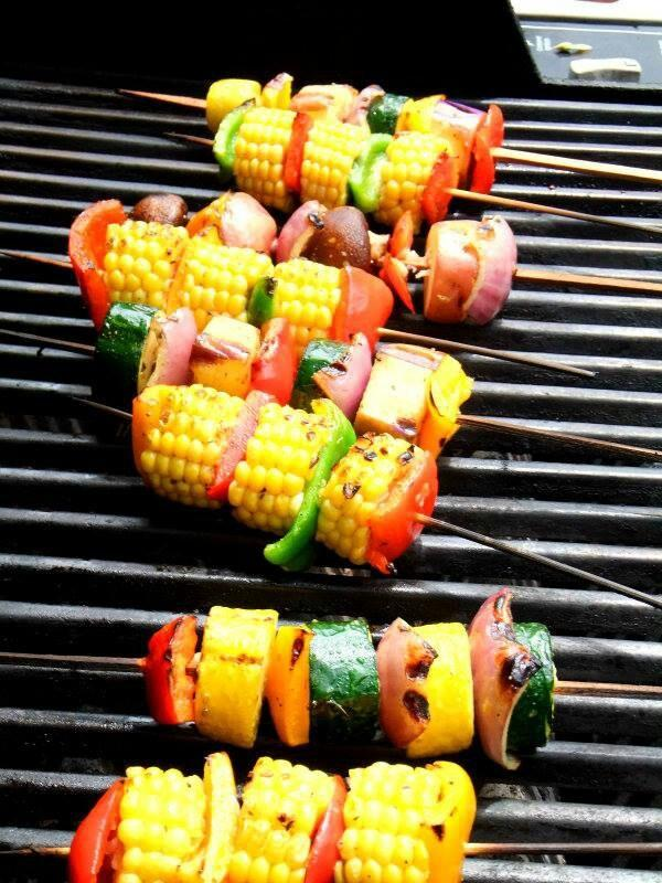 Assorted skewered vegetables on the grill.