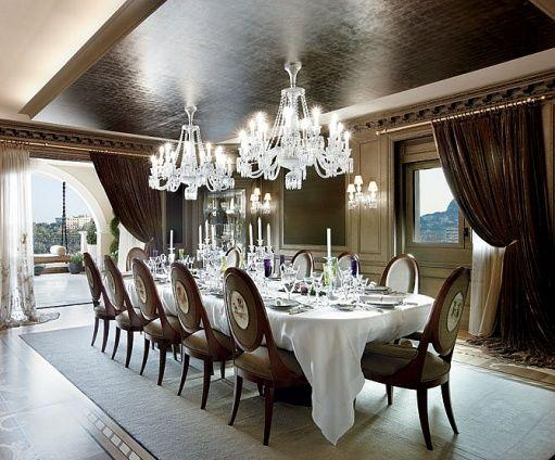 Grand dining room with two statement chandeliers.