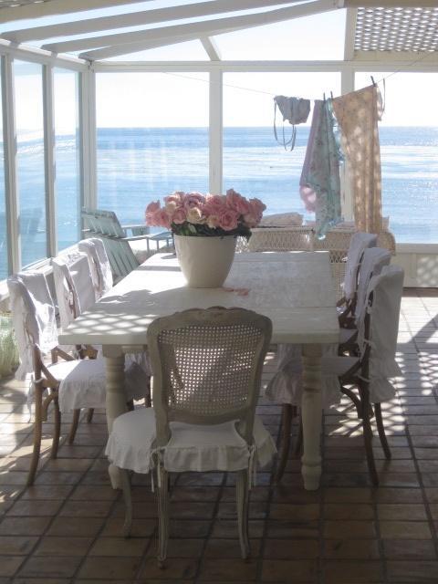 Dining area with plenty of full length windows.