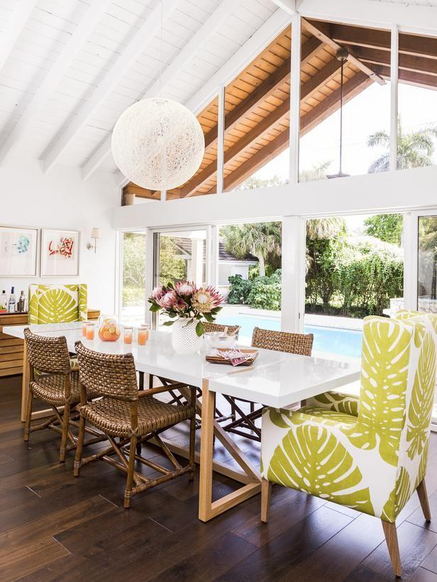 Tropical dining space with printed fabric chairs.