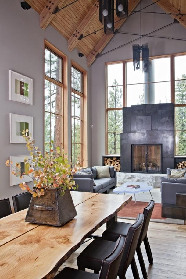 Grey-coloured space with grey and black elements and natural wood.